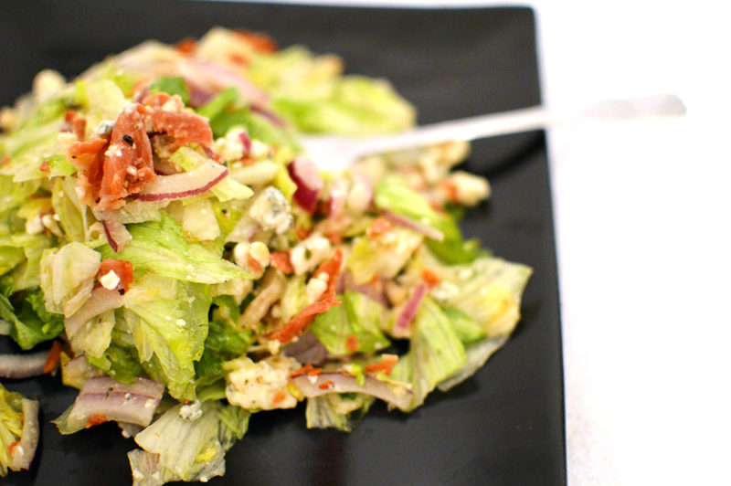 This salad combines salty prosciutto, gorgonzola cheese, red onion, chopped lettuce and homemade Italian dressing. It's everything that makes you happy!
