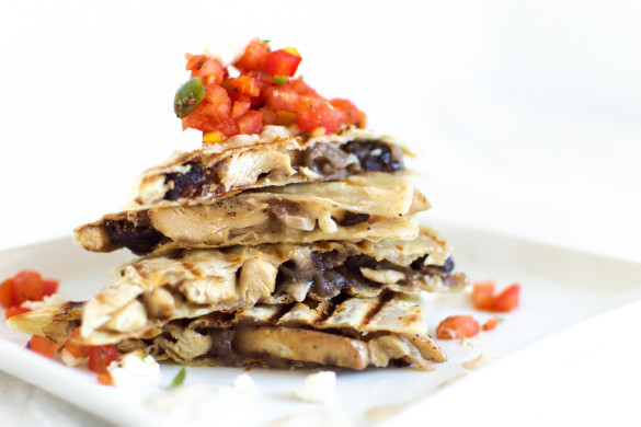I put a twist on the Mexican style chicken quesadilla and added some Mediterranean flavors! Sliced chicken on a corn tortilla with feta, onions, and figs. Serve with harissa, bell pepper and tomato salsa, and drizzle with an herby sour cream sauce.