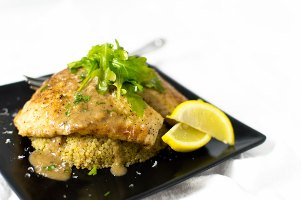 Pan-fried tilapia over a serrano-garlic quinoa topped with a bright, flavorful 4 herb Chardonnay sauce.