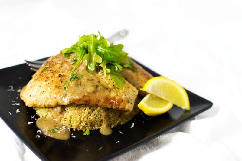 This tilapia is pan-seared and finished in the oven, then topped with a lemony-white wine sauce. I served over serrano-garlic quinoa.