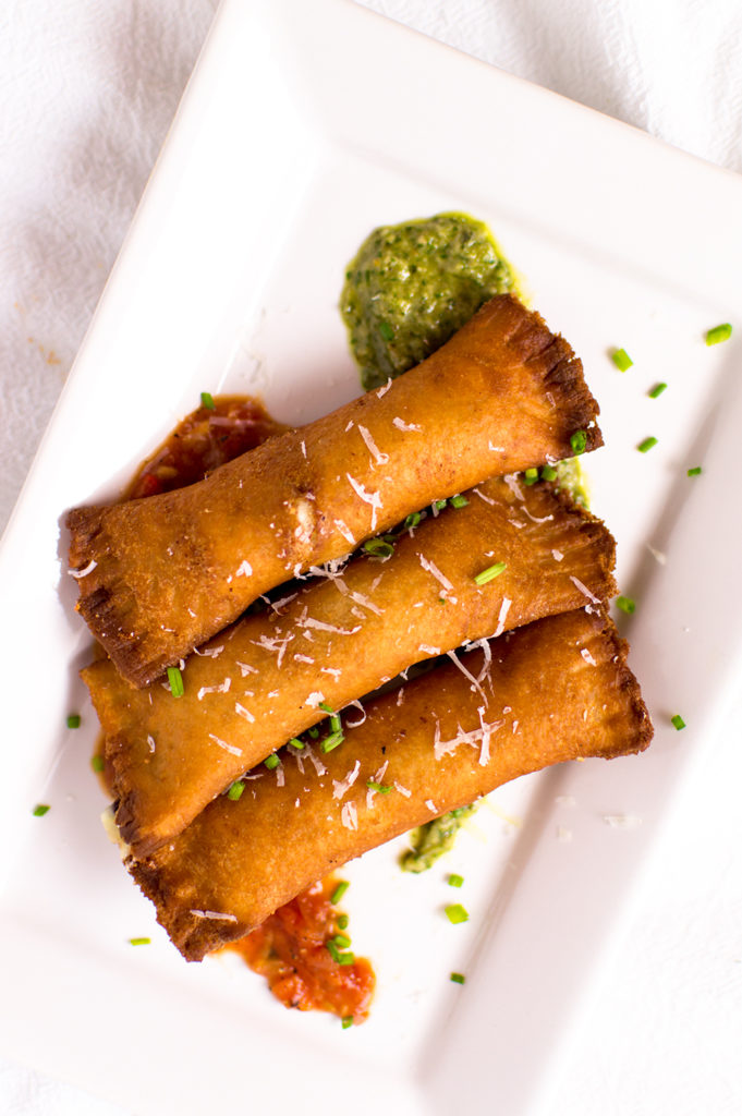 Perfectly fried cheese sticks made with flattened white bread on the outside and filled with a mixture of mozzarella and goat cheeses.